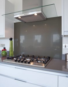 kitche cooking ovn with dark splashback